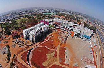 An aerial view of Actis' flagship Garden City mixed-use property development in Nairobi, Kenya during construction phase.
