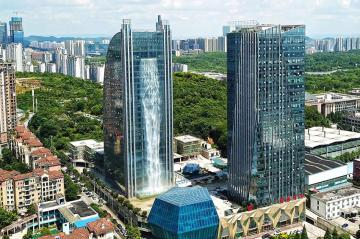 Liebian International Building, a new skyscraper in Guiyang, southwest China which boasts a 350-foot (108 metres) waterfall constructed into its glass facade.