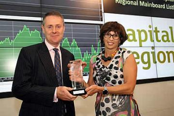Charles Staveley, CEO of Capital & Regional seen at the JSE listing event with Donna Oosthuyse, Director of Capital Markets at the Johannesburg Stock Exchange.