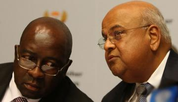 South Africa's former Finance Minister Nhlanhla Nene has a word with the reappointed Finance Minister Pravin Gordhan. Gordhan will come back in the position he had previously held for five years.
