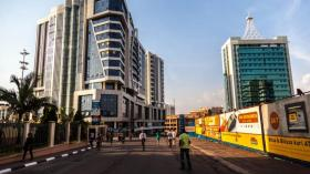 Pedestrans walk through the Car-Free Zone in Rwanda's Kigali. The country has become an investor magnet because of its stable political climate and its economic growth
